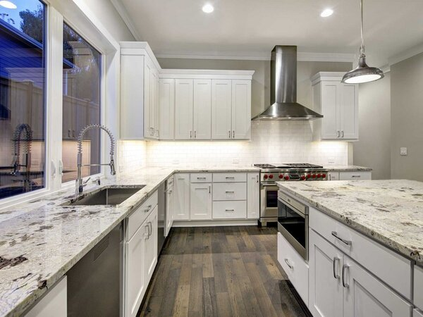 White painted kitchen cabinets in a more modern looking kitchen